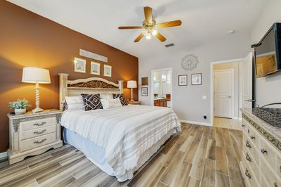 """Decorated in vintage """"pooh bear"""" the master bedroom is a peaceful retreat"""