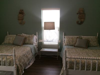 Sweet ground floor bedroom with two comfortable full sized beds.