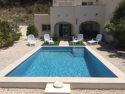 Photo for Luxury Ibiza style 4 bedroom villa with secure garden, private & communal pools