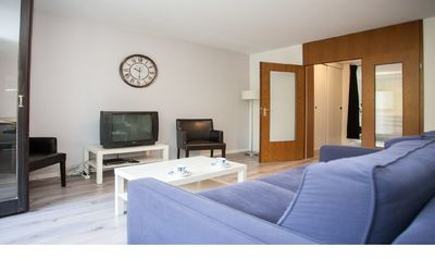 Photo for Cozy apartment with communal pool and sauna in a quiet location