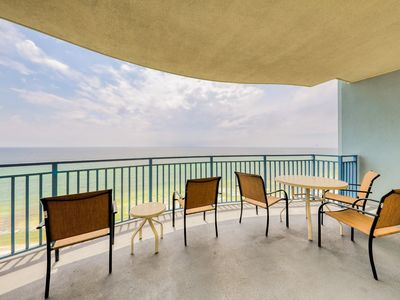 Photo for Spacious beachfront condo w/ full kitchen - edge pool & cafe on-site!