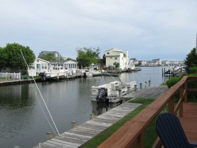 Photo for FREE DAILY ACTIVITIES INCL! Lovely beach getaway tucked away in a private quiet bayside community on the water