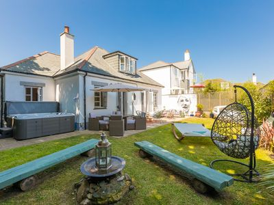 Photo for Beautiful beach house with hot tub & private gardens moments from beaches & town