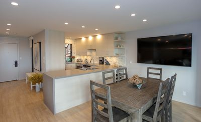 Modern open-concept kitchen & dining area with fantastic entertainment system