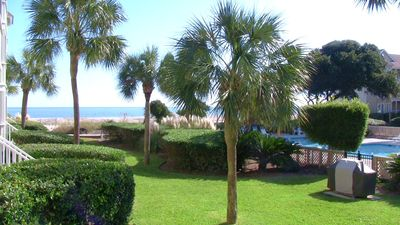 View of the pool and ocean from the screened porch