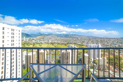 Balcony with breathtaking mountain and city views