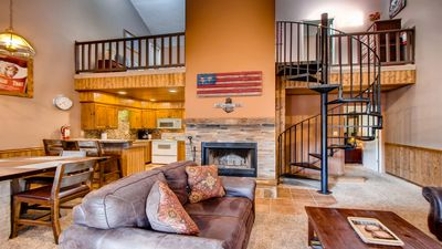 Enjoy Family time in this Spacious well designed rustic living room!