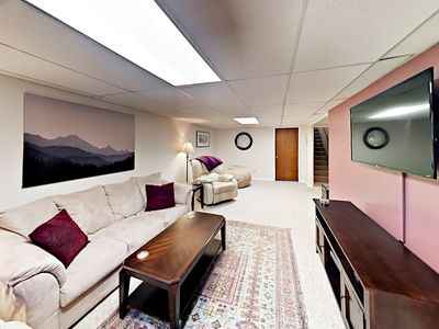 """2nd Living Room - A 2nd living room boasts a queen sleeper sofa, 2 recliners, and a bean bag chair, as well as a 50"""" TV equipped with DIRECTV and a sound bar."""