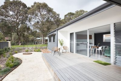 Deck area,kitchen,dining,lounge inside.Coffee towards trees 1 minute walk!