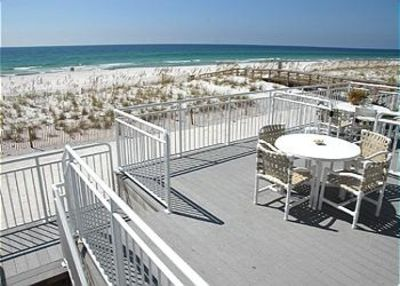 Main Deck, Table, Chairs, & Umbrella, Lounge, and Plenty of Stackable Chairs