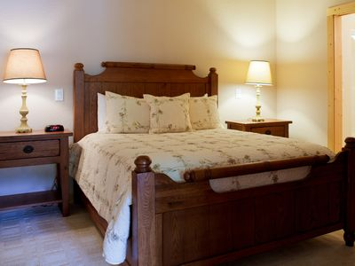 Photo for Southern chic bedroom bathed in natural light