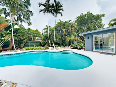 Photo for Tropical Triplex 4BR w/ Private Pool - Walk to Eateries, 4.5 Miles to Beach