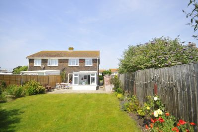 A sunny south-facing back garden, perfect for kids and eating outside...