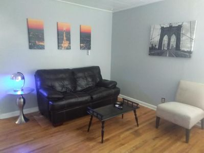 Living room, with cool silver lamp and blue light.