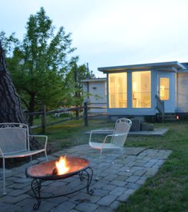 Rear exterior view showing screen porch and fire pit.