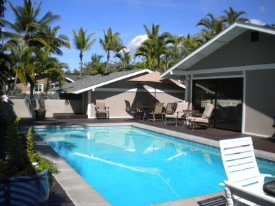 Private solar heated pool with coconut palm views.