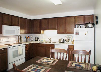 Very well equipped kitchen for home cooking! Seating for four at dining table