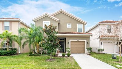 Photo for Beautiful 5 Bed Gated Pool Home At Paradise Palms