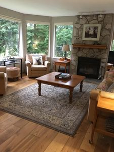 Living room - bright and sunny with golf course & mountain views!