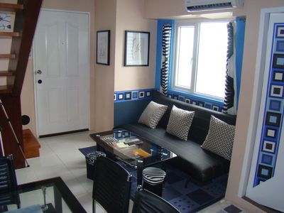Photo for 2BR with a Grand View 26th Floor at Victoria de Manila - Taft Ave