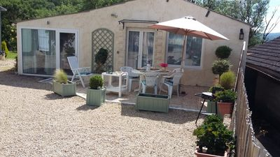 Photo for Cozy cottage with pool near Rocamadour