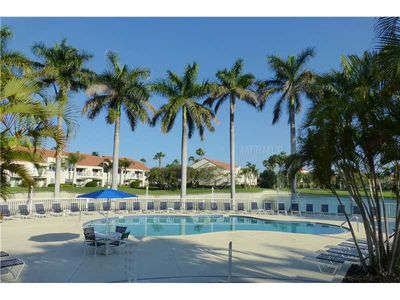 Photo for Ground Floor Corner Unit Overlooking Pool, Pond & Golf Course
