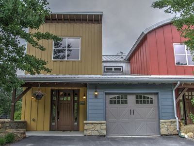 Photo for The swiftwater is rushing by, as you enjoy this luxury townhome.  WiFi, hot tub, dog friendly, A/C,