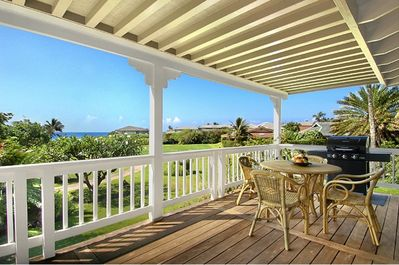 Covered ocean view lanai - The spacious covered lanai fronts the living area of the house and provides panoramic views of Shipwreck's Beach and rolling green landscaped walkway to a variety of beaches, the pool and hot tub, tennis, dining and shopping.