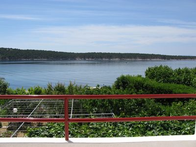 Photo for Holiday apartment with balconies and sea views right on the water