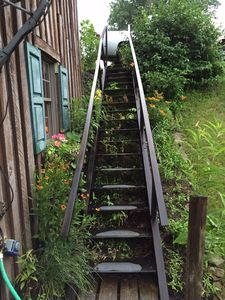 Vintage iron outside stairs lead to lower level. (also stairs inside)
