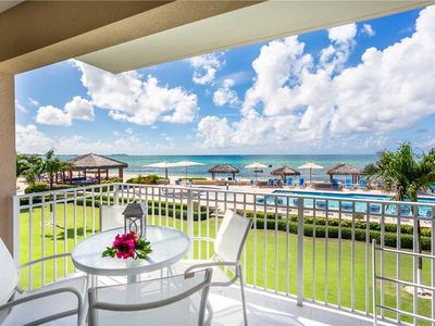 Photo for Take in stunning views of the Caribbean sea in this charming, 3-bedroom condo on Seven Mile Beach