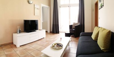 Photo for Bright & modern mezzanine floor apartment just 100 meters from the sea - FREE. Wi-Fi