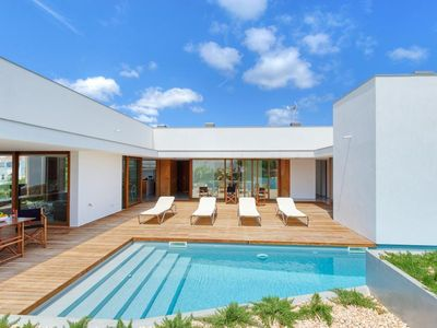 Photo for 4 bedroom Villa, sleeps 9 in Punta Prima with Pool, Air Con and WiFi
