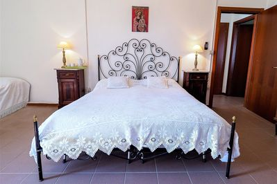 Queen size bed dressed in antique Tuscan lace