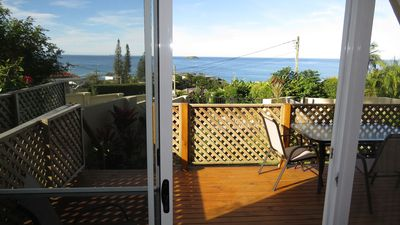 View from inside studio to deck and ocean.