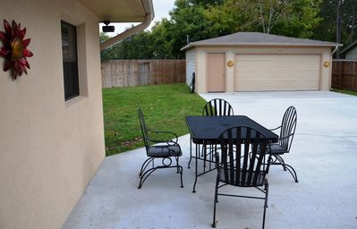 Patio with Relaxing outside sitting area + 2 Car Garage