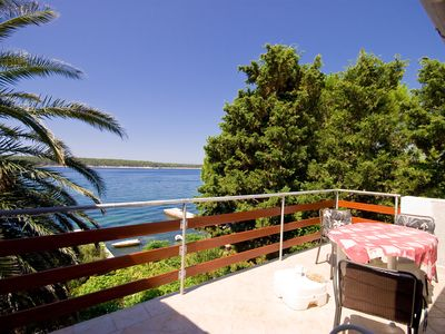 Photo for Apartment on the seafront of the island of Rab with private beach