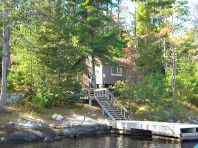 View of dock leading to deck and cabin