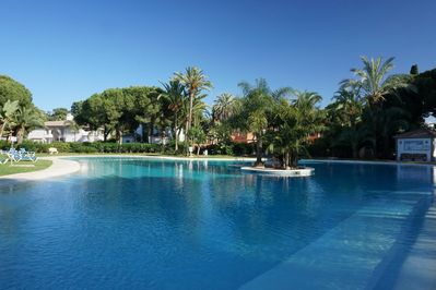 The main pool has a kids pool and gradual entry with numerous sunbeds.