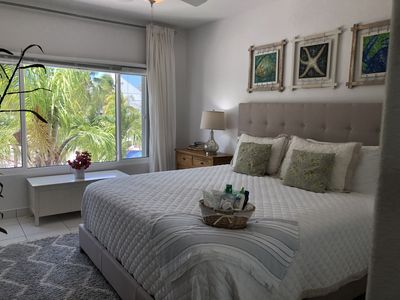 Photo for Relax & watch sunsets over sparkling  waters. Ocean Front 2 Bd, 2 bth, & Pool