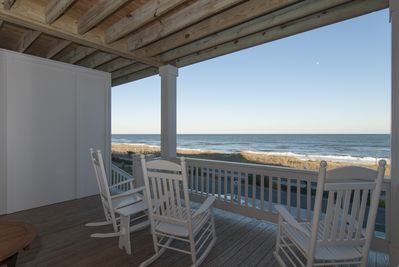 Covered oceanfront deck area off living room.