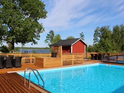 Photo for Luxury cottage - lake view, heated pool, wifi, boat with electric motor, cleaning included