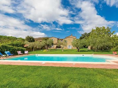 Photo for Located in a serene corner of the Tuscan countryside, bounded by olive trees and woods lies this beautiful villa overlooking the Trasimeno Lake