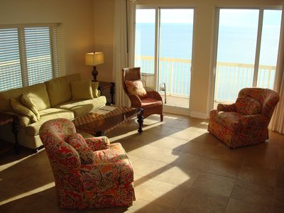 Spacious living room with new tile and wrap around views of the Gulf