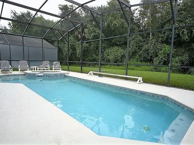 Photo for 6 Bedroom Pool Home with CONSERVATION VIEW, GAMES ROOM & OUTDOOR SPA! Stay close to just about every