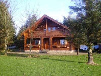 Photo for Luxurious Riverfront Log Cabin set in a tranquil woodland location