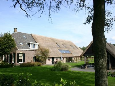 Photo for Nostalgic farmhouse with covered terrace near the Dwingelderveld National Park.