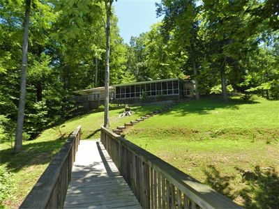 Photo for A Quiet Cove - Cozy Lakefront Cottage, Screened Porch, Large Private Dock, Canoe! Short Stays Available!