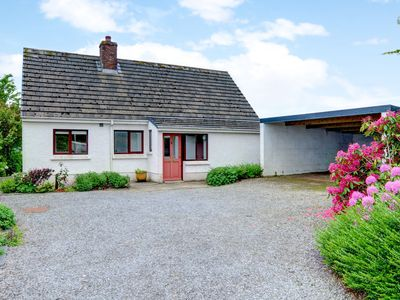 Photo for Detached holiday home with large garden, cosy furnishings and lots of space for playing