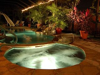 Large tropical garden waterfall pool with spa